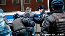 Russian police search an opposition activist during a protest rally in central Moscow on November 5, 2017. Radical opposition activist Vyacheslav Maltsev had appealed on his website for his supporters to hold protests across Russia on November 5, calling for a people's Revolution and for an immediate end to Putin's rule. More than 200 people were detained at a Moscow anti-Putin protest, Russian police said. / AFP PHOTO / Maxim ZMEYEV (Photo credit should read MAXIM ZMEYEV/AFP/Getty Images)