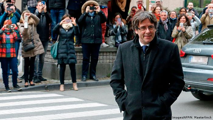 Dismissed Catalonia's leader Carles Puigdemont arrives to address media representatives at The Press Club in Brussels