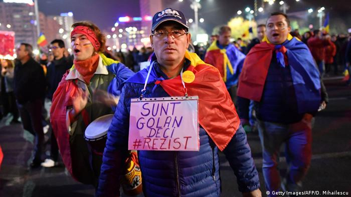Around 12,000 of Romanians took the streets in Bucharest and in a dozen major cities (Getty Images/AFP/D. Mihailescu)