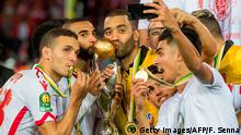 04.11.2017+++ Wydad Casablanca's players celebrate with their trophy after winning the CAF Champions League final football match between Egypt's Al-Ahly and Morocco's Wydad Casablanca on November 4, 2017, at Mohamed V Stadium in Casablanca. / AFP PHOTO / FADEL SENNA (Photo credit should read FADEL SENNA/AFP/Getty Images)