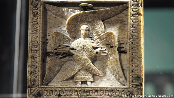 A quadratic ivory relief of an angel with six wings