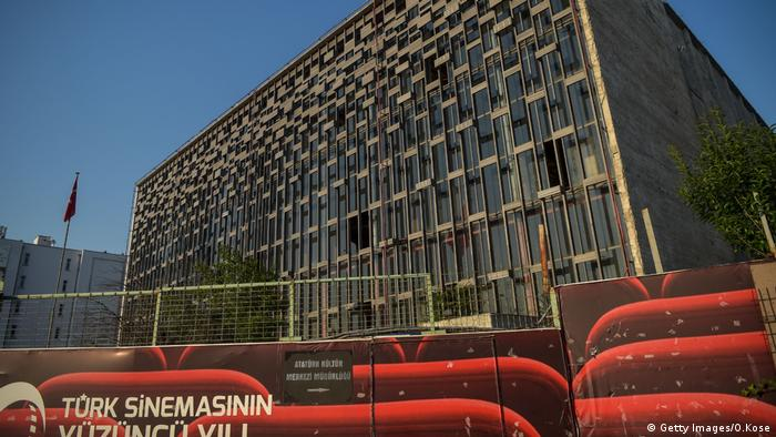 A large glass-fronted building fronted with placards on the streets (AKM) (Getty Images/O.Kose)