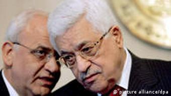 Palestinian President Mahmoud Abbas (R) talks with his top aide, Saeb Erekat (L), during a press conference following his meeting with Egyptian President Hosni Mubarak (unseen) in Cairo, Egypt on 28 December 2008. Talks focused on the Israeli attacks against Hamas-ruled Gaza, where over 270 people were killed and more than 900 wounded. EPA/KHALED EL-FIQI +++(c) dpa - Report+++