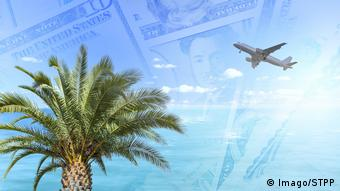 Photo montage showing a palm tree, dollar notes and an aeroplane