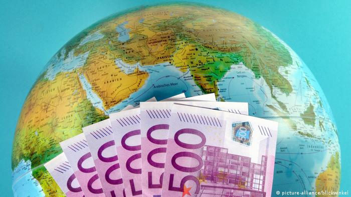 Bank notes in front of a globe
