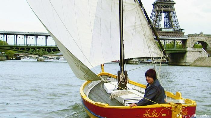 Scene from The Beaches of Agnes in which Varda is sailing a small boat on the River Seine, with the Eiffel Tower in the background (picture-alliance/dpa)