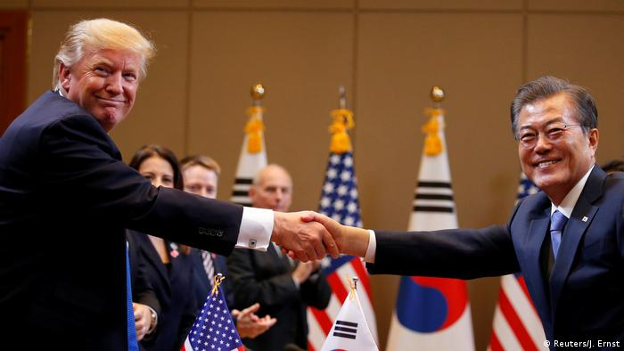 US President Donald Trump and South Korean President Moon Jae-in shake hands during a meeting at South Korea's presidential Blue House in Seoul, South Korea,