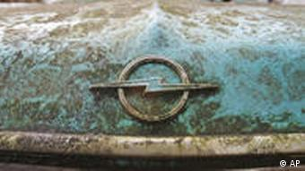 An Opel logo is seen at an old Opel Rekord car at a car wasteyard in Duisburg