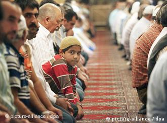 Muslims at prayer in a mosque in Cologne
