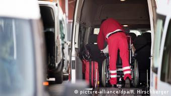Man pushing wheelchair onto a van in Potsdam (picture-alliance/dpa/R. Hirschberger)