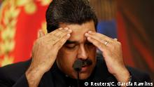 Venezuela's President Nicolas Maduro gestures as he talks to the media during a news conference at Miraflores Palace in Caracas, Venezuela October 17, 2017. REUTERS/Carlos Garcia Rawlins