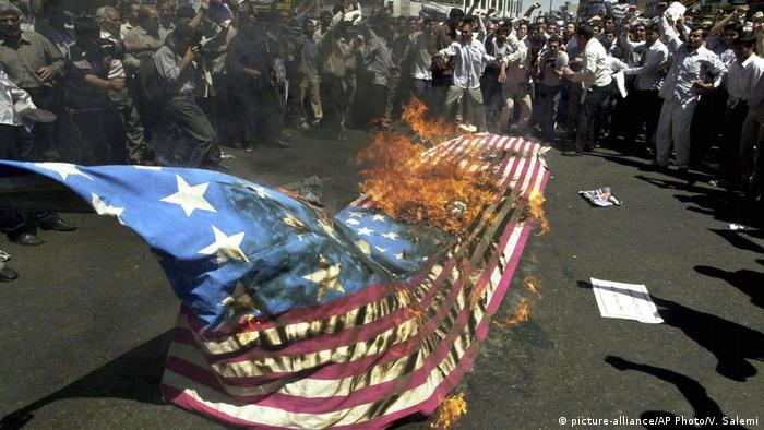 US flag being burnt in Iran