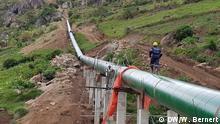 Uganda - Arbeiten am Bau eines Wasserkraftwerks am Fluss Lubilia