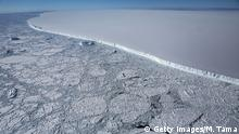 UNSPECIFIED, ANTARCTICA - OCTOBER 31: The western edge of the famed iceberg A-68 (TOP R), calved from the Larsen C ice shelf, is seen from NASA's Operation IceBridge research aircraft, near the coast of the Antarctic Peninsula region, on October 31, 2017, above Antarctica. The massive iceberg was measured at approximately the size of Delaware when it first calved in July. NASA's Operation IceBridge has been studying how polar ice has evolved over the past nine years and is currently flying a set of nine-hour research flights over West Antarctica to monitor ice loss aboard a retrofitted 1966 Lockheed P-3 aircraft. According to NASA, the current mission targets 'sea ice in the Bellingshausen and Weddell seas and glaciers in the Antarctic Peninsula and along the English and Bryan Coasts.' Researchers have used the IceBridge data to observe that the West Antarctic Ice Sheet may be in a state of irreversible decline directly contributing to rising sea levels. The National Climate Assessment, a study produced every 4 years by scientists from 13 federal agencies of the U.S. government, released a stark report November 2 stating that global temperature rise over the past 115 years has been primarily caused by 'human activities, especially emissions of greenhouse gases'. (Photo by Mario Tama/Getty Images)