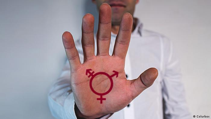 A hand with a symbol of third gender (Colurbox)