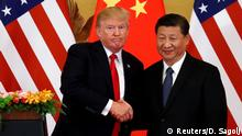 09.11.2017 *** U.S. President Donald Trump and China's President Xi Jinping make joint statements at the Great Hall of the People in Beijing, China, November 9, 2017. REUTERS/Damir Sagolj