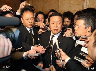 Japan's Defence Minister Yasukazu Hamada speaking to reporters about North Korea on Friday