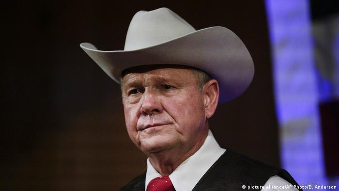 Head shot of Roy Moore wearing a cowboy hat, a tie and a vest