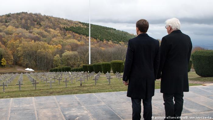 Emmanuel Macron and Frank-Walter Steinmeier view the memorial