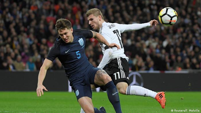 Timo Werner and Harry Maguire challenge for the ball (Reuters/T. Melville)