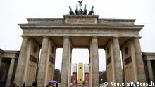 An installation Monument by German-Syrian artist Manaf Halbouni stands in front the Brandenburg Gate in Berlin, Germany, November 10, 2017. The installation, previously displayed in Dresden, displays three upended buses to mimic a defensive barricade erected in Aleppo, in Syria, to protect people from sniper fire. REUTERS/Fabrizio Bensch