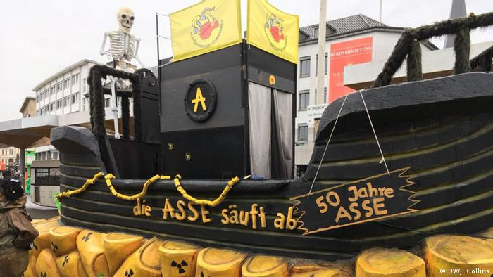 A float showing a pirate ship navigating a sea of nuclear waste