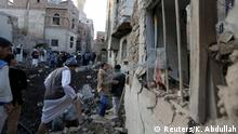 People gather at the site of an air strike in Sanaa, Yemen November 11, 2017. REUTERS/Khaled Abdullah