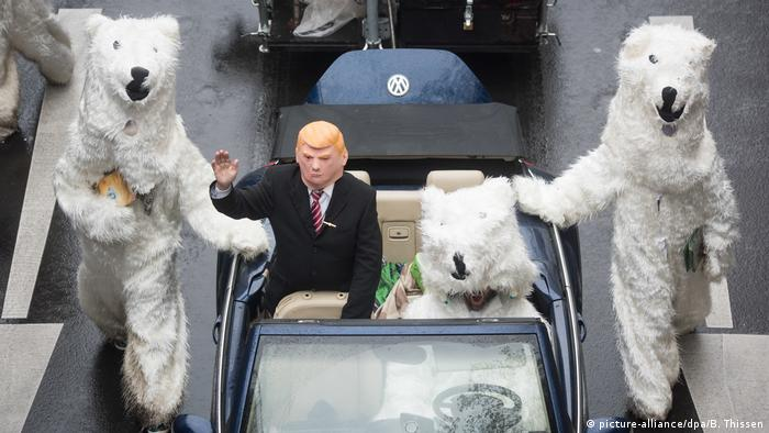 Polar bears and man in Trump mask at a climate protest in Bonn