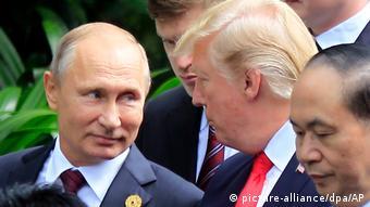 Russian President Vladimir Putin, left, and U.S. President Donald Trump talk