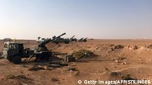 Artillery are seen lined up in the village of Suway'iah, near the Syrian border town of Albu Kamal, on November 10, 2017. / AFP PHOTO / STRINGER (Photo credit should read STRINGER/AFP/Getty Images)