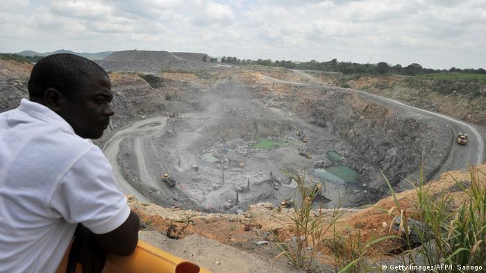 A man looks at a diamond mine in Kono district, Sierra Leone
