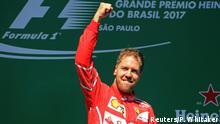 Formula One F1 - Brazilian Grand Prix 2017 - Sao Paulo, Brazil - November 12, 2017 Ferrari's Sebastian Vettel celebrates winning the race on the podium REUTERS/Paulo Whitaker