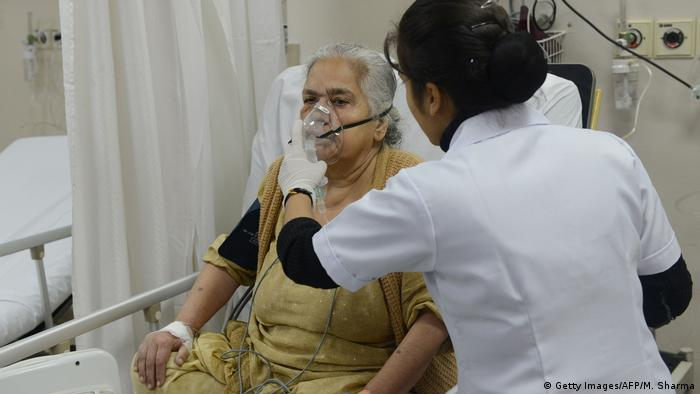 A doctor treating a patient using a nebuliser