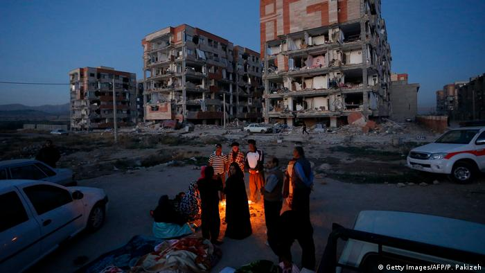 Residents huddle by an open fire after a 7.3 magnitude earthquake struck the Iran-Iraq border. (Getty Images/AFP/P. Pakizeh)