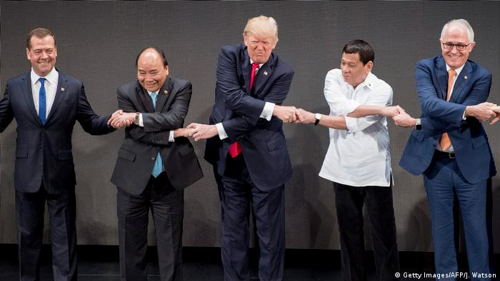 US President Donald Trump shakes hands with Philippine President Rodrigo Duterte and Vietnam's Prime Minister Nguyen Xuan Phuc