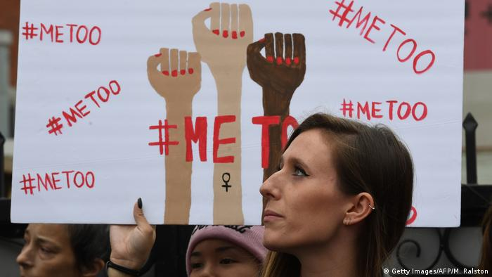 A poster reading #MeToo, with three clenched fists held up in the air