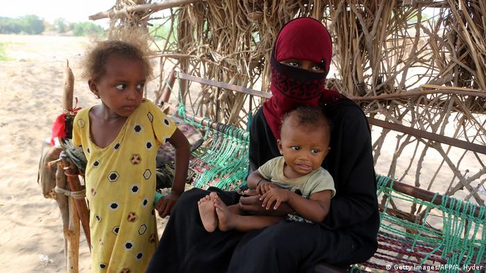 A poor family sits in a hut in Hodeidah