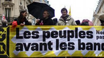 Protesters hold a banner reading People before bankers as part of a demonstration against the upcoming G20 summit, in Paris
