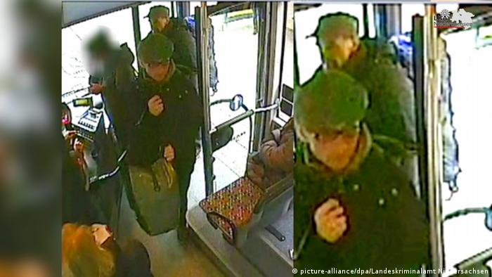 One of the police videos shows Garweg (front) getting on a bus with Staub (behind) carrying heavy bags