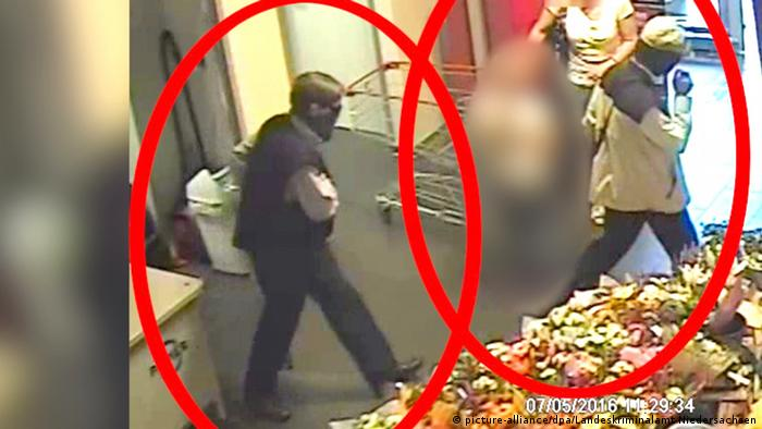 A still-shot from a police video of ex-RAF members allegedly robbing a grocery store