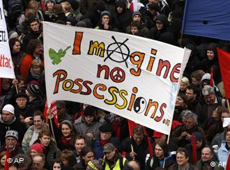 People in Frankfurt carrying a banner reading Imagine No Possessions