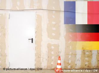 closed door with German and french flags