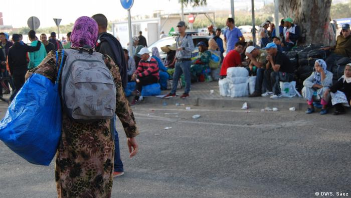 A group of refugees from Maghreb wait to cross the Melilla border
