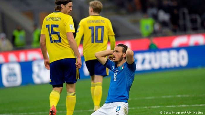 Alessandro Florenzi holds his head in his hands against Sweden