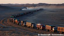 Thousands of heavy-duty trucks loaded with coal are lined up for up to 130 kilometres from the Mongolia-China border on a sole road in the Gobi desert, Mongolia, October 29, 2017. The journey can take more than a week. REUTERS/B. Rentsendorj SEARCH RENTSENDORJ KHANBOGD FOR THIS STORY. SEARCH WIDER IMAGE FOR ALL STORIES.