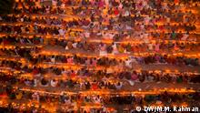 Title: Rakher Upobash Rituals Description: Hindu devotees pray for the well-being of their loved ones at the Loknath Ashram in Bangladesh after day-long fasting on Saturdays and Tuesdays in the second half of Bangla month, Kartik, as part of the Rakher Upabash or Kartik Brata rituals. DW, Muhammad Mostafigur Rahman