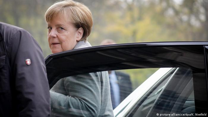 German Chancellor Angela Merkel exits a car