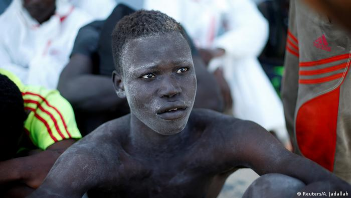 A migrant after being rescued off the coast of Libya (Reuters/A. Jadallah)