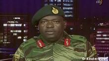 15.11.2017+++ Zimbabwe Defence Forces Major-General SB Moyo makes an announcement on state broadcaster ZBC, in this still image taken from a November 15, 2017 video. ZBC/Handout via REUTERS ATTENTION EDITORS - THIS IMAGE HAS BEEN SUPPLIED BY A THIRD PARTY. NO RESALES. NO ARCHIVES. ZIMBABWE OUT. NO COMMERCIAL OR EDITORIAL SALES IN ZIMBABWE