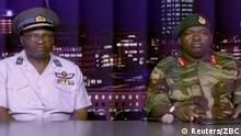 15.11.2017+++ Zimbabwe Defence Forces Major-General SB Moyo (R) makes an announcement on state broadcaster ZBC, in this still image taken from a November 15, 2017 video. ZBC/Handout via REUTERS ATTENTION EDITORS - THIS IMAGE HAS BEEN SUPPLIED BY A THIRD PARTY. NO RESALES. NO ARCHIVES. ZIMBABWE OUT. NO COMMERCIAL OR EDITORIAL SALES IN ZIMBABWE